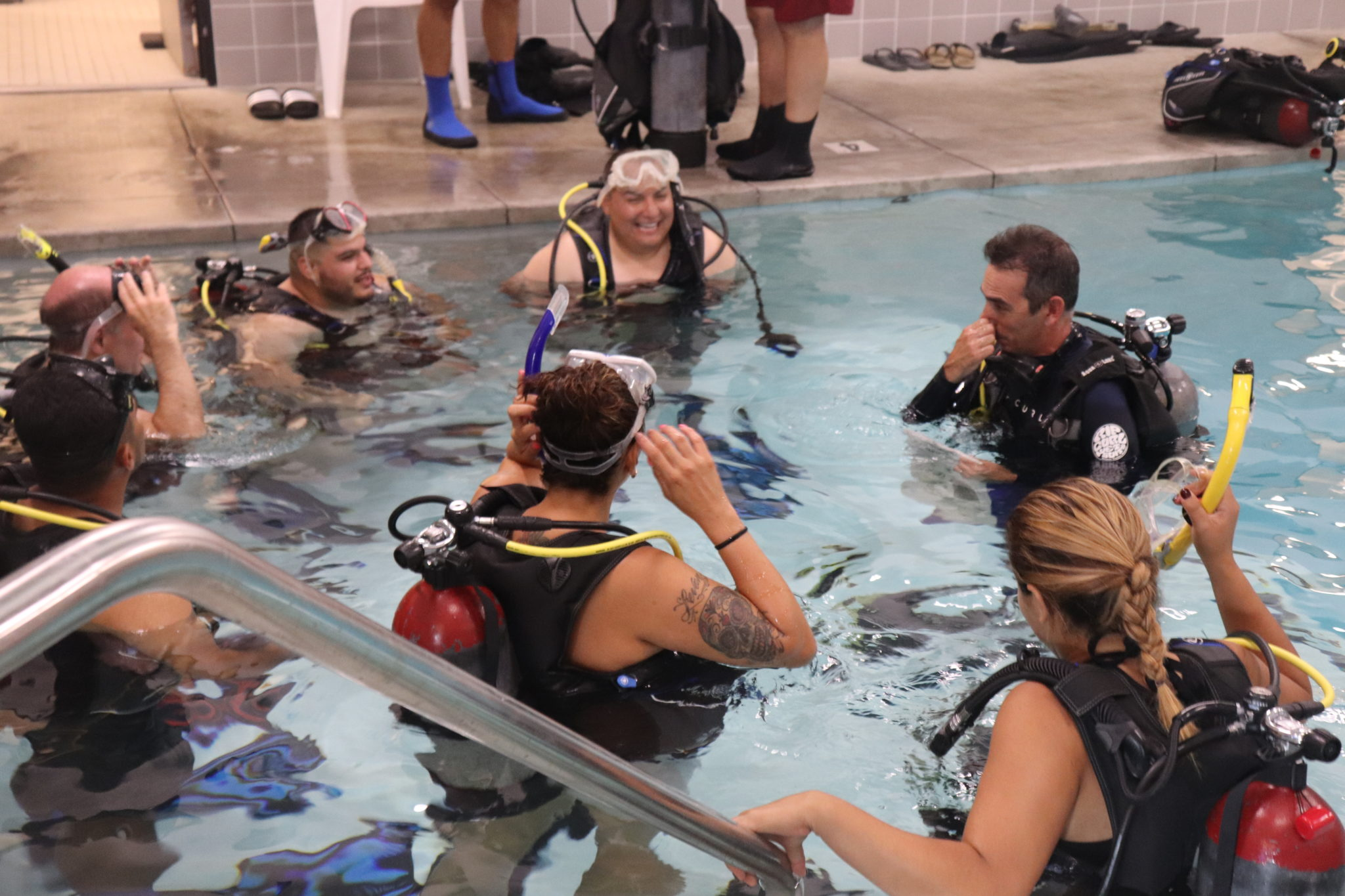 Scuba divers taking a class in a pool