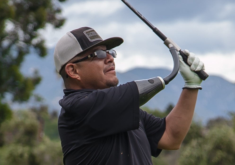 Disabled veteran participating at wounded heroes of america's annual golf tournament